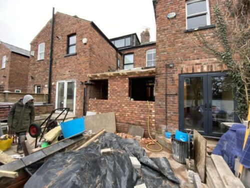 Two extensions in Chorlton sharing a party wall
